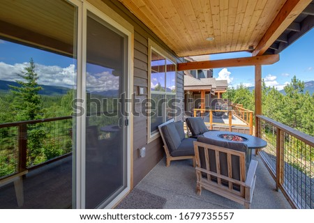 Amazing balcony patio with fire pit and forest and mountains view. Dream come true home exterior. New American architecture. Comfortable and beautiful home details. #1679735557