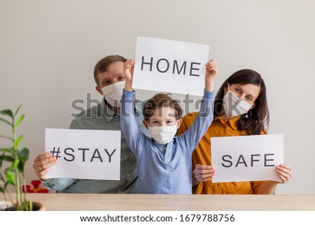 Lettering Stay Home Safe Campaign. A happy european family remained at quarantine self-isolation. Pandemic coronavirus covid 19 responsibility conscious decision. message poster preventive measures #1679788756