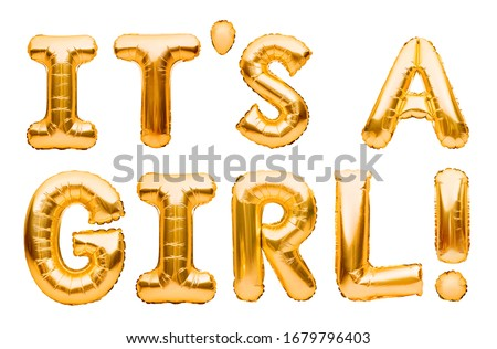 Phrase IT'S A GIRL made of golden inflatable balloons isolated on white background. Gold foil helium balloons. Baby arrival announcement, birthday congratulations concept, happy birthday wishes