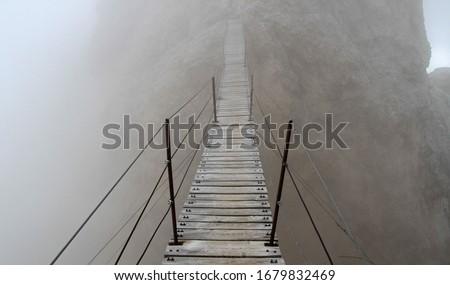Ponte Cristallo, famous wooden suspension bridge on Monte Cristallo, Dolomites, Italy Royalty-Free Stock Photo #1679832469