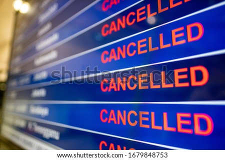 Airport screen indicating cancelled flights due to the Coronavirus pandemic  Royalty-Free Stock Photo #1679848753