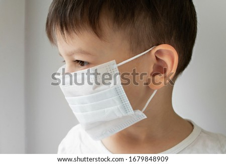Sick boy in a medical protective mask #1679848909