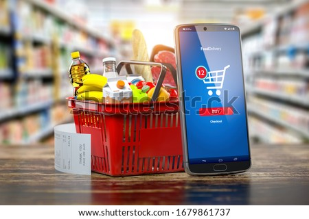 Shopping basket with fresh food and smartphone. Grocery supermarket, food and eats online buying and delivery concept. 3d illustration