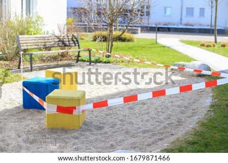 Playground closing by barrier tape no entry during coronavirus,Covid-19 pandemic outbreak everywhere around Munich, Bayern, Germany. #1679871466