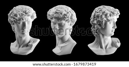 Gypsum statue of David's head. Michelangelo's David statue plaster copy isolated on black background. Ancient greek sculpture, statue of hero #1679873419