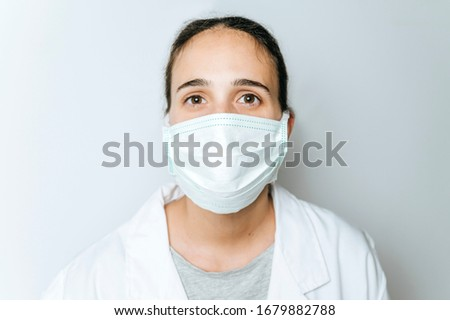 Portrait of female doctor with surgical mask #1679882788