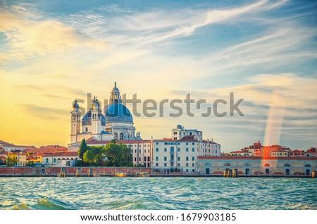 Santa Maria della Salute Roman Catholic church and Punta della Dogana, Venice historical city centre, promenade waterfront of Giudecca Canal, Veneto Region, Italy. Venice cityscape amazing sunset #1679903185