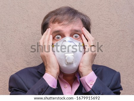Anonymous businessman with mask fears virus outbreak #1679915692