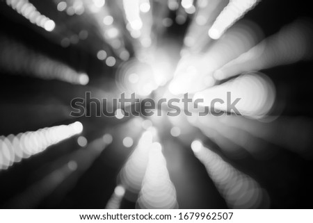 abstract background of blurred white bokeh is on  black background that is dispersing. #1679962507
