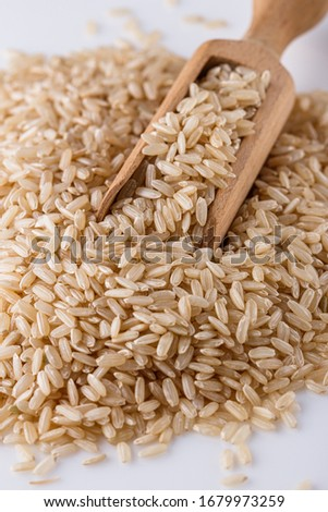 raw brown rice on white acrylic background #1679973259