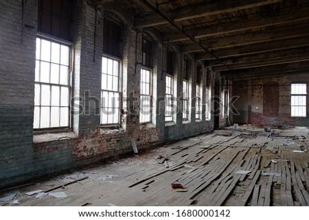 Old rundown warehouse with windows.  #1680000142