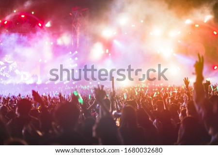 crowd with raised hands at concert festival #1680032680