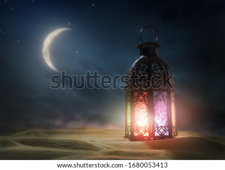 Ornamental Arabic lantern with burning candle glowing at night. Festive greeting card, invitation for Muslim holy month Ramadan Kareem. #1680053413