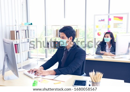 Businessman or office worker are working and wear mask for protect Covid-19 or corona virus disease but business must be continuous, healthcare concept  Royalty-Free Stock Photo #1680058567