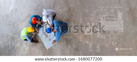 Top view of architectural engineer working on his blueprints with documents on construction site. meeting, discussing,designing, planing, roof plan #1680077200