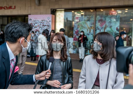 Tokyo, Japan - 03.14.2020 - TV interview, japanese wearing protective masks, coronavirus pandemia #1680101206