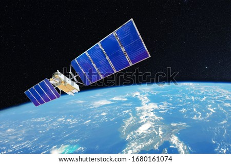 Space satellite orbiting over the ocean earth. Elements of this image furnished by NASA Royalty-Free Stock Photo #1680161074