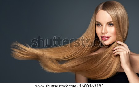 Beautiful model woman with shiny  and straight long hair. Keratin  straightening. Treatment, care and spa procedures. Blonde beauty  girl smooth hairstyle #1680163183