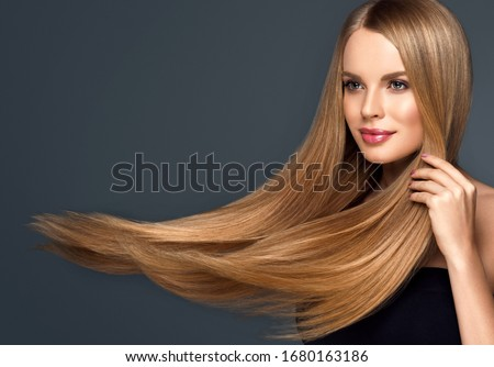 Beautiful model woman with shiny  and straight long hair. Keratin  straightening. Treatment, care and spa procedures. Blonde beauty  girl smooth hairstyle Royalty-Free Stock Photo #1680163186