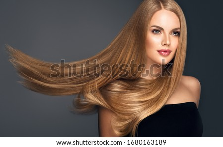 Beautiful model woman with shiny  and straight long hair. Keratin  straightening. Treatment, care and spa procedures. Blonde beauty  girl smooth hairstyle #1680163189