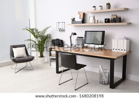 Modern computer on table in office interior. Stylish workplace Royalty-Free Stock Photo #1680208198
