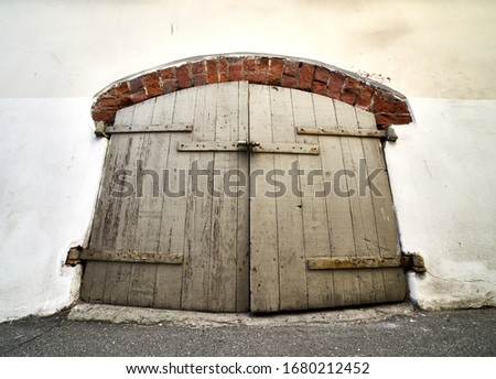 vintage wooden door on the white background Royalty-Free Stock Photo #1680212452