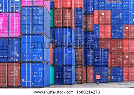 aerial top view container ship crane Lifting container for Logistic by sea in warehouse. Royalty-Free Stock Photo #1680214273