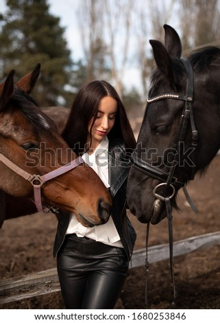 Beautiful young brunette girl, two horses, black and brown horse, horsewoman, black and bay color, photo shoot with animals #1680253846