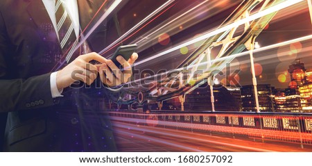 double exposure picture and vector compile of businessman wearing suit using mobile with long exposure bridge and city skylines at not and bokeh, concept of usage speed of technology with modern world
