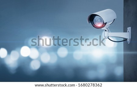 Close up of CCTV camera over defocused background with copy space #1680278362