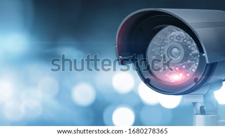 Close up of CCTV camera over defocused background with copy space Royalty-Free Stock Photo #1680278365