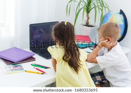 Covid-19 Coronavirus and Learning from home, Home school kid concept. Little children study online learning from home with laptop. Quarantine and Social distancing concept. Royalty-Free Stock Photo #1680353695