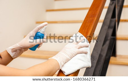 Deep cleaning for Covid-19 disease prevention. alcohol,disinfectant spray on Wipes of Banister in home for safety,infection of Covid-19 virus,contamination,germs,bacteria that are frequently touched . #1680366271