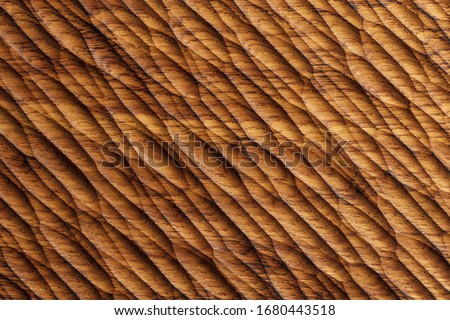Wood Board carving. Oak wood texture background. Wooden pattern Handmade. Royalty-Free Stock Photo #1680443518