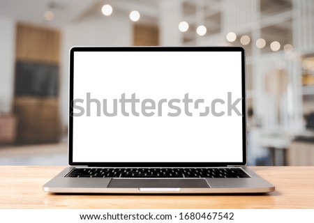 Laptop blank screen on wood table with coffee cafe background, mockup, template for your text, Clipping paths included for background and device screen Royalty-Free Stock Photo #1680467542