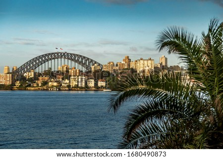 Sydney in Australia, taking pictures of the skyline with the Harbour Bridge during a cloudy but warm day.