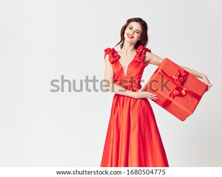 Cheerful woman in dress decorating luxury gift charm #1680504775