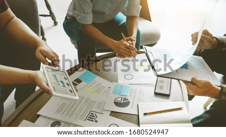 Business people meeting at office writing memos on sticky notes. planning strategy and brainstorming, colleagues thinking concept #1680524947