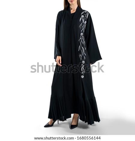 Arabic Muslim woman in stylish abaya, in white background - Image Royalty-Free Stock Photo #1680556144