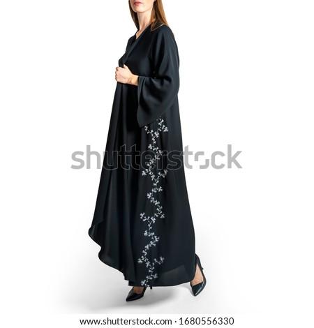 Arabic Muslim woman in stylish abaya, in white background - Image Royalty-Free Stock Photo #1680556330