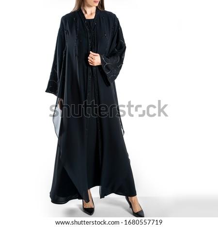 arabic muslim woman in stylish abaya, in white background - Image Royalty-Free Stock Photo #1680557719