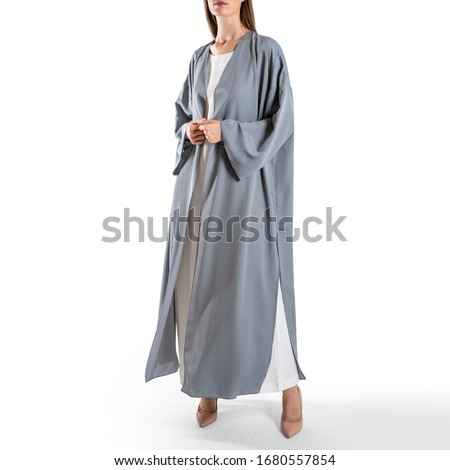 arabic muslim woman in stylish abaya, in white background - Image Royalty-Free Stock Photo #1680557854