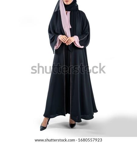 arabic muslim woman in stylish abaya, in white background - Image Royalty-Free Stock Photo #1680557923