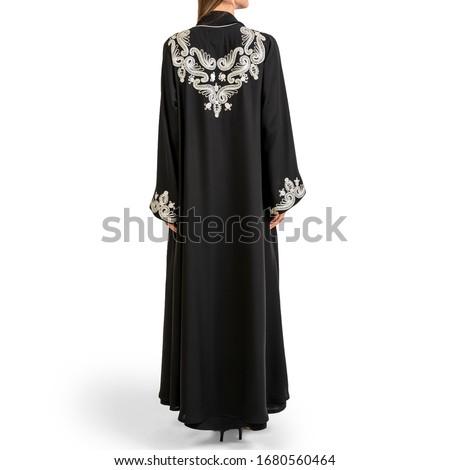 Arabic Muslim woman in stylish abaya, in white background - Image Royalty-Free Stock Photo #1680560464
