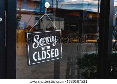 """""""Sorry we're closed"""" message board on a window Royalty-Free Stock Photo #1680587521"""