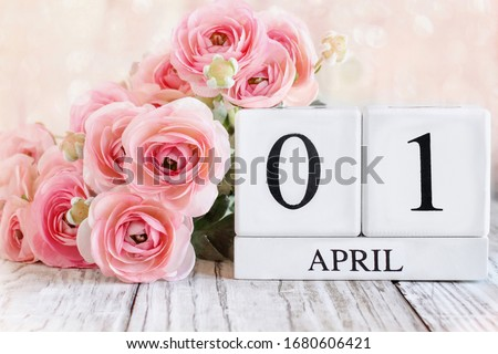 White wood calendar blocks with the date April 1st for April Fool's Day. Selective focus with blurred background. Royalty-Free Stock Photo #1680606421