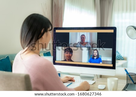 Asian business woman talking to her colleagues about plan in video conference. Multiethnic business team using computer for a online meeting in video call. Group of people smart working from home.  #1680627346