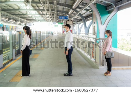 Three Asian people wearing mask standing distance of 1 meter from other people keep distance protect from COVID-19 viruses and people social distancing  for infection risk  #1680627379