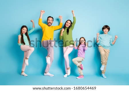 Full length body size view of nice attractive lovely adorable ecstatic overjoyed cheerful cheery big full family celebrating luck isolated on bright vivid shine vibrant blue color background