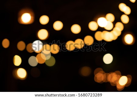 Blurred light bokeh of party outdoor on night background #1680723289